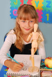 Schoolgirl on drawing lesson Royalty Free Stock Images
