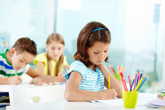 Schoolgirl at drawing lesson Stock Photos