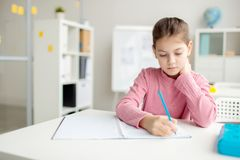 Schoolgirl drawing stock photo