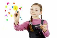 Schoolgirl draws butterflies and the sun Stock Image