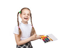 Schoolgirl draws paints Stock Photo