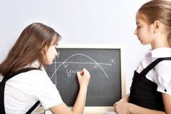 Schoolgirl, draws the schedule Royalty Free Stock Photos