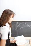 Schoolgirl, draws the schedule Stock Photo