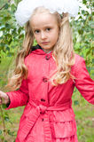 Schoolgirl dressed in birch forest Royalty Free Stock Image