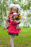Schoolgirl dressed with a bouquet Royalty Free Stock Photos
