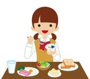 Schoolgirl eating  Breakfast- Long Sleeved.  Stock Photos