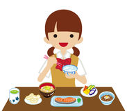 Schoolgirl eating Japanese breakfast Royalty Free Stock Photo