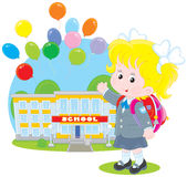 Schoolgirl. Elementary school student with a schoolbag before a school with flying holiday balloons Stock Images