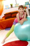 Schoolgirl with exercise ball Stock Image
