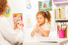 Schoolgirl exercises putting fingers with teacher royalty free stock image