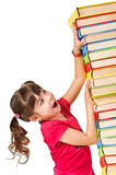 Schoolgirl with the falling pile of books Stock Photo