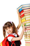 Schoolgirl with the falling pile of books Stock Images