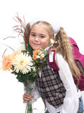 Schoolgirl with flowers Royalty Free Stock Photo