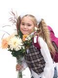 Schoolgirl with flowers Royalty Free Stock Photo