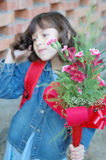 Schoolgirl with flowers royalty free stock photography