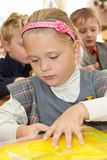 Schoolgirl with a folder in classroom Royalty Free Stock Images