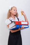 Schoolgirl with folders Stock Image