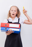 Schoolgirl with folders Royalty Free Stock Images