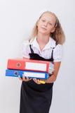 Schoolgirl with folders Stock Photography