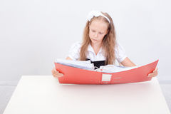 Schoolgirl with folders Royalty Free Stock Photos