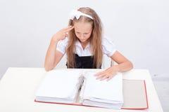Schoolgirl with folders Royalty Free Stock Photo