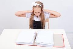 Schoolgirl with folders Stock Photos