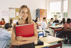 Schoolgirl in front of her class Royalty Free Stock Photography