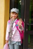 Schoolgirl in the front of school Royalty Free Stock Photos