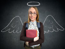 Schoolgirl with funny angel wings Stock Image