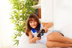Schoolgirl with game controller Stock Photography