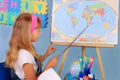 Schoolgirl on geography lesson Royalty Free Stock Images