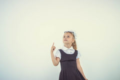 Schoolgirl get an idea Stock Images