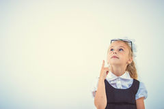 Schoolgirl get an idea Royalty Free Stock Images