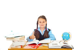Schoolgirl giving thumb up royalty free stock photos