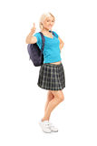 Schoolgirl giving a thumb up Royalty Free Stock Image