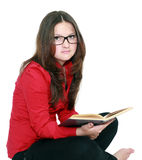 Schoolgirl in glasses with a book. Isolated background Royalty Free Stock Images