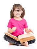 Schoolgirl with glasses holding big book. isolated on white Stock Photos
