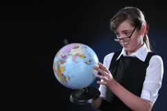 Schoolgirl and globe Royalty Free Stock Images
