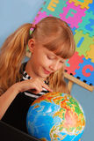 Schoolgirl with globe Royalty Free Stock Images