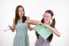 Schoolgirl got a bad grade and tear notebook Royalty Free Stock Photo