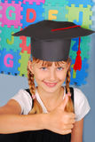 Schoolgirl in graduation cap Royalty Free Stock Photography