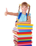 Schoolgirl with group of books and thumb up. Royalty Free Stock Photography
