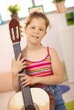 Schoolgirl with guitar Royalty Free Stock Photography