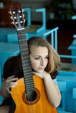 Schoolgirl with a guitar Stock Photos