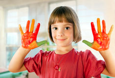 Schoolgirl hands painted in colorful paints Stock Images