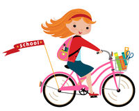 Schoolgirl. Happy girl going to school by cycle Royalty Free Stock Photography