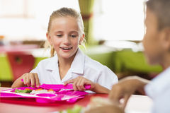 Schoolgirl having lunch during break time in school cafeteria Royalty Free Stock Image