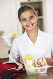 Schoolgirl With Healthy Lunchbox In Kitchen Stock Photography
