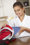 Schoolgirl With Healthy Lunchbox In Kitchen Stock Image