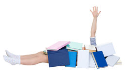 Schoolgirl heap up with books Royalty Free Stock Images